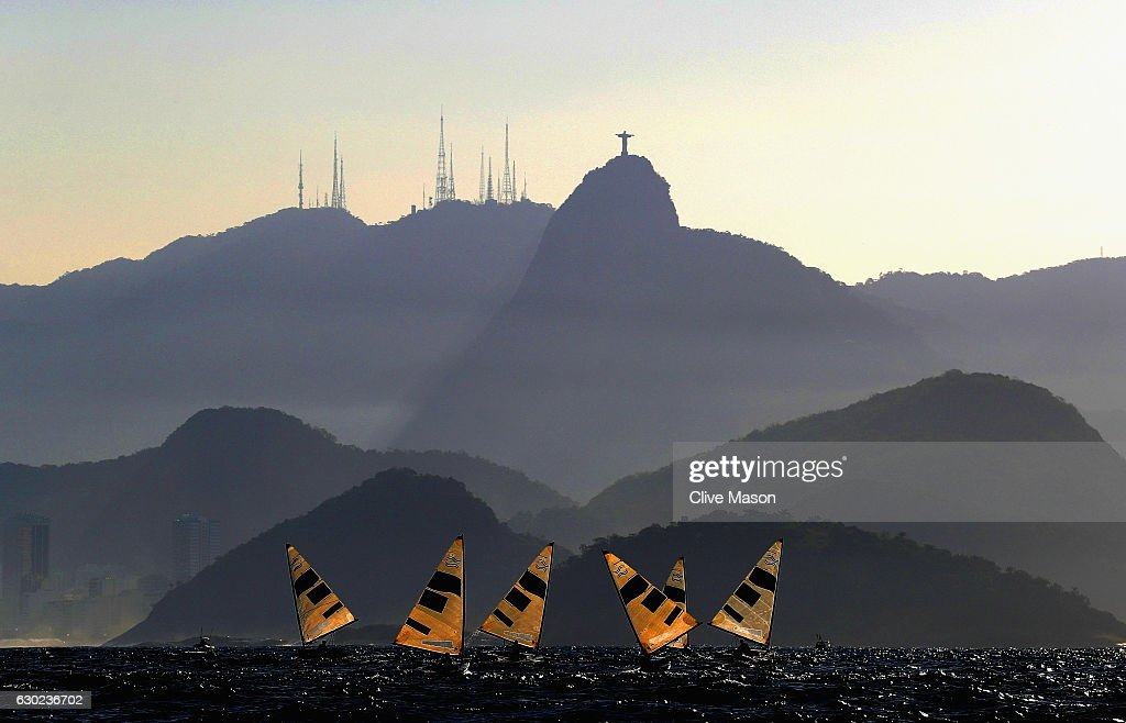 The Finn Class fleet in action during their second race of the day on Day 9 of the Rio 2016 Olympic Games at the Marina da Gloria on August 14, 2016 in Rio de Janeiro, Brazil.