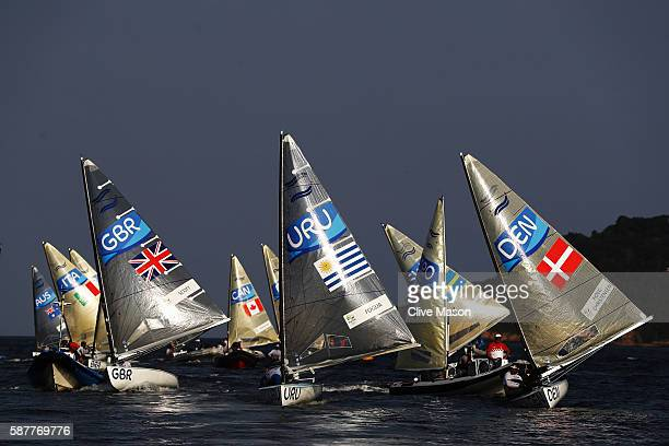 The Finn class fleet in competition on Day 4 of the Rio 2016 Olympic Games at the Marina da Gloria on August 9 2016 in Rio de Janeiro Brazil