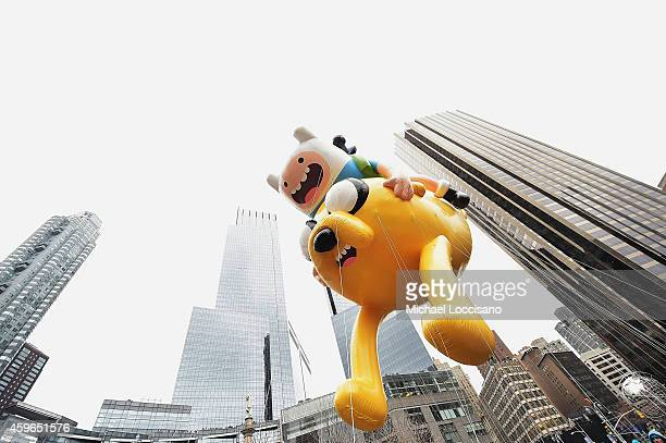 The Finn 'n Jake Adventure Time balloon passes by during the 88th annual Macy's Thanksgiving Day Parade on November 27 2014 in New York City Over...