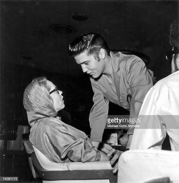 The Finnish born actress and TV hostess Maila Nurmi aka Vampira chats with Elvis Presley on May 3 1956 in Los Angeles California