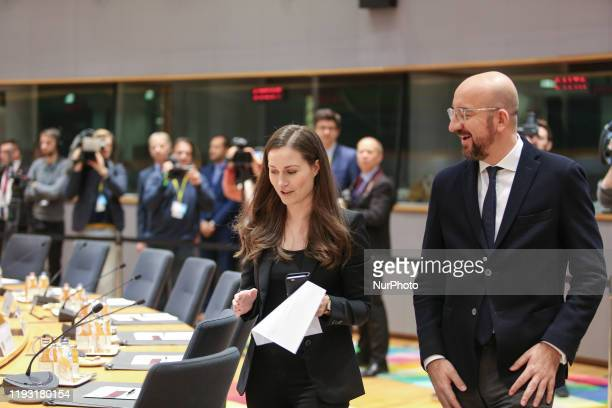 The Finnish PM talks to the President of the European Council Charles Michel. Prime Minister of Finland Sanna Mirella Marin on the round table room...