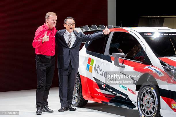 The Finnish rally driver Tommi Makinen poses next to President and CEO of Toyota Motor Corporation Akio Toyoda who presents their latest Toyota Yaris...