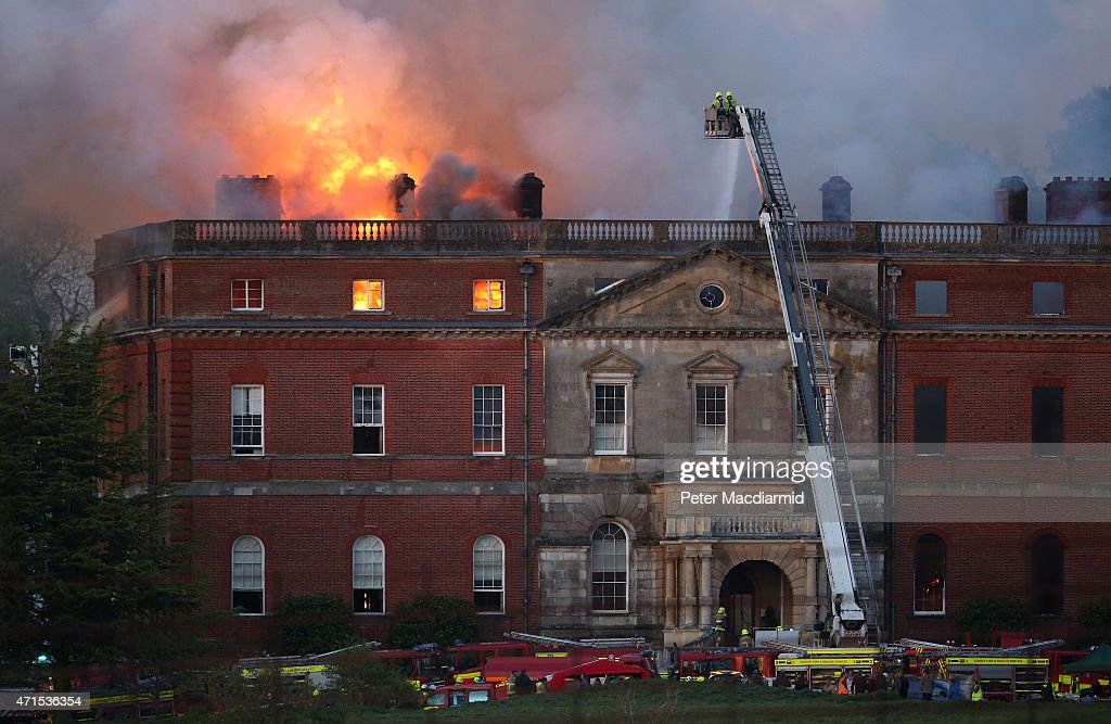 The Fire brigade attempt to put out a large fire at Clandon Park House on April 29, 2015 in Guildford, England. 60 fire officers are attending the fire, which started in the basement of the 18th century house.