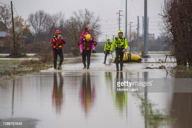 The Fire Brigade rescues a young girl isolated in her house due to the flooding of the Panaro River on December 06, 2020 in Modena, Italy.