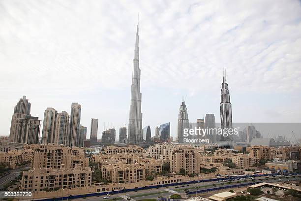 The fire damaged Address Downtown Dubai hotel developed by Emaar Properties PJSC right stands on the city skyline alongside skyscrapers including the...
