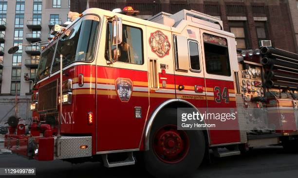 The Fire Department of the City of New York Engine 34 pulls away from its fire station on 38th Street in Hell's Kitchen on February 13 2019 in New...