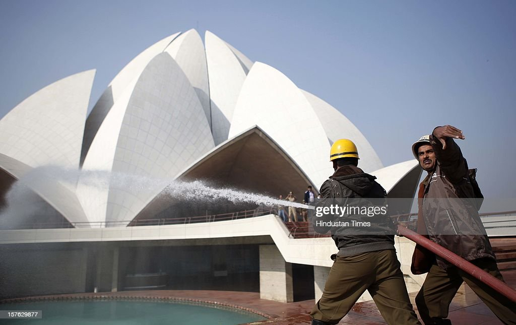 The fire fighter participating in a mock drill in Lotus Temple on December 4, 2012 in New Delhi, India. A mock drill held in the capital under which simulated situations was created across the city to check medical response system of prominent hospitals in the city in the event of an earthquake, fire and bomb blasts.