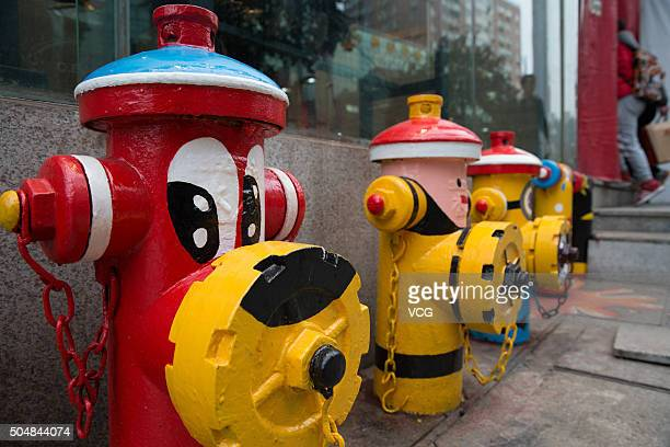 The fire hydrants are painted as cartoon characters at Xinjiekou the central business district on January 13 2016 in Nanjing Jiangsu Province of...