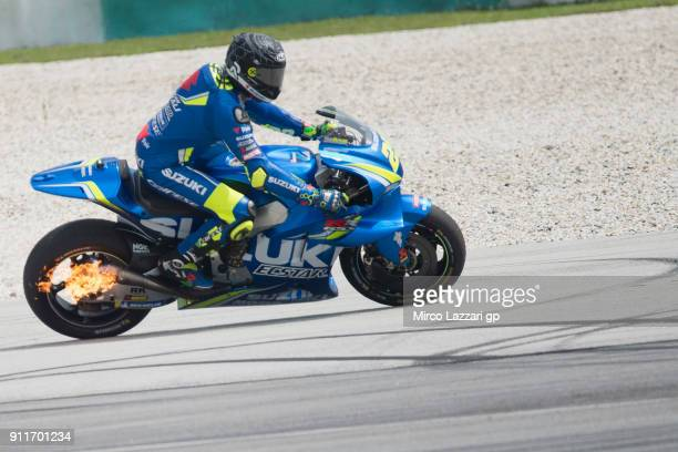 The fire on the bike of Andrea Iannone of Italy and Team Suzuki ECSTAR during the MotoGP Tests In Sepang at Sepang Circuit on January 29 2018 in...