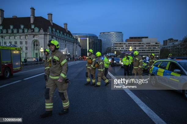 The Fire service and Police officers are seen applauding NHS staff and key workers on Westminster Bridge on April 09, 2020 in London, England....