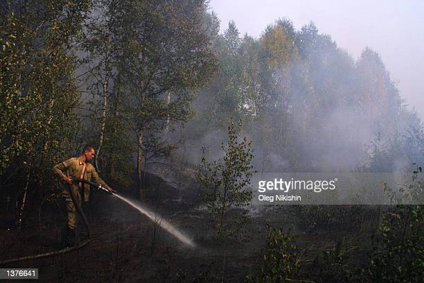 The fireman extinguishes burning turbaries September 5 2002 outside of Moscow near Shatura Russia Smoke hung over much of Moscow and the surrounding...
