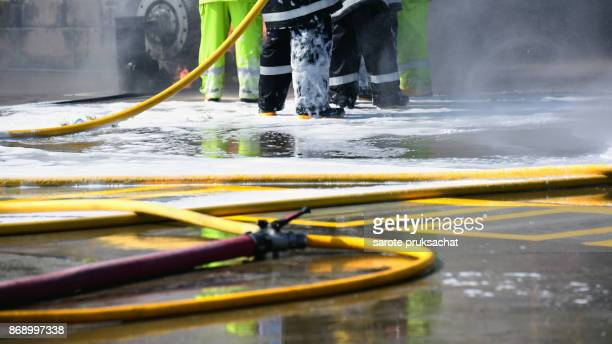 The fireman extinguishes the fire with foam ,Background for emergency  response .