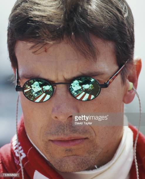 The Firestone Patrick Racing Lola T96/00 Ford Cosworth is reflected in the sunglasses of driver Scott Pruett of the United States during the...