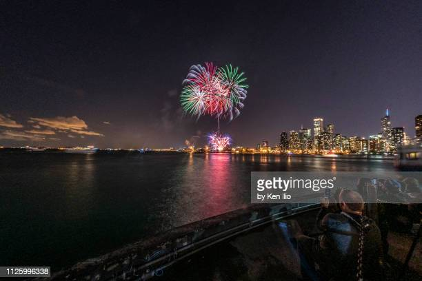 the fireworks and the city behind - ken ilio stock photos and pictures