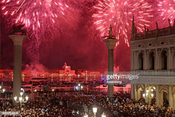 The fireworks display on the San Marco basin seen from the Palazzo Ducale loggia on the occasion of the traditional feast of the Holy redeemer on...
