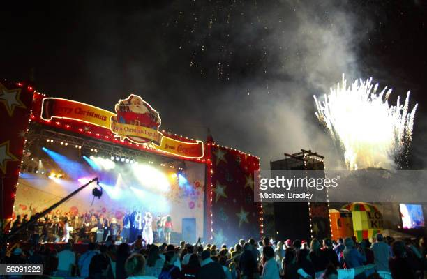 The fireworks go off during the last song at the Coca Cola Christmas in the Park Saturday