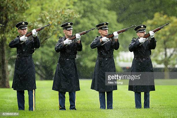 The firing party fires shots during the funeral of Army Corporal David J Wishon at Arlington National Cemetery May 6 2016 in Arlington Virginia...