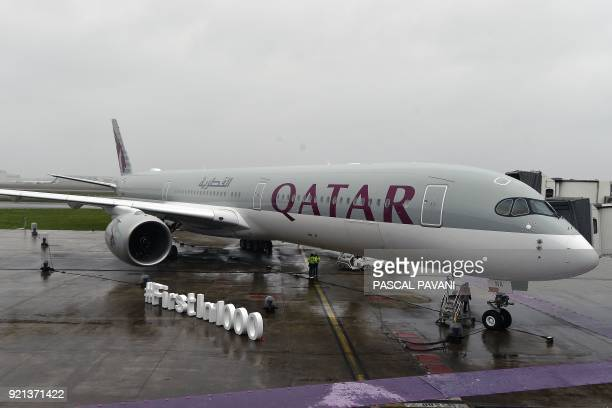 The first Airbus A3501000 bearing the logo of Qatar Airways is stationed on the tarmac on February 20 2018 at the Airbus delivery center in Colomiers...