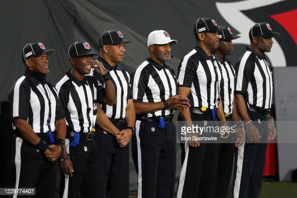 The first all-Black officiating crew which includes Referee Jerome Bogar in white hat, Barry Anderson , Julian Mapp , Carl Johnson , Anthony Jeffries...