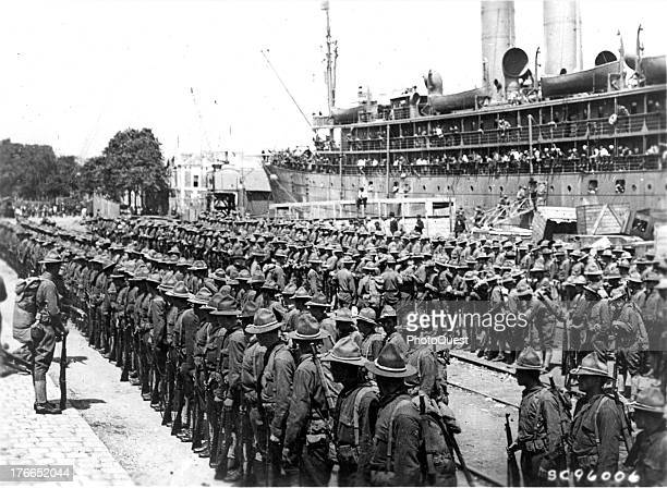 The first American troops arrive, St. Nazaire, France, June 26, 1917.