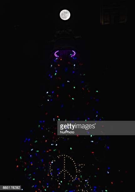 The first and only supermoon of the year the December 3 2017 Frost Moon is seen behind a replica of the Liberty Bell atop a 52foot tall holiday tree...