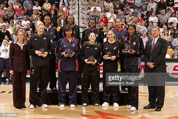 The first and second team All WNBA poses for a portrait on the court President of the WNBA Val Ackerman Lauren Jackson of the Seattle Storm Tina...