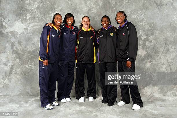 The first and second team All WNBA poses for a portrait Tamika Catchings of the Indiana Fever Tina Thompson of the Houston Comets Diana Taurasi of...