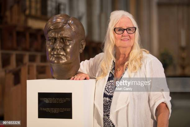 The first baby born on the NHS Aneira Thomas who is also a retired nurse poses for a photograph besides a bust of NHS founder Aneurin Bevan at a...