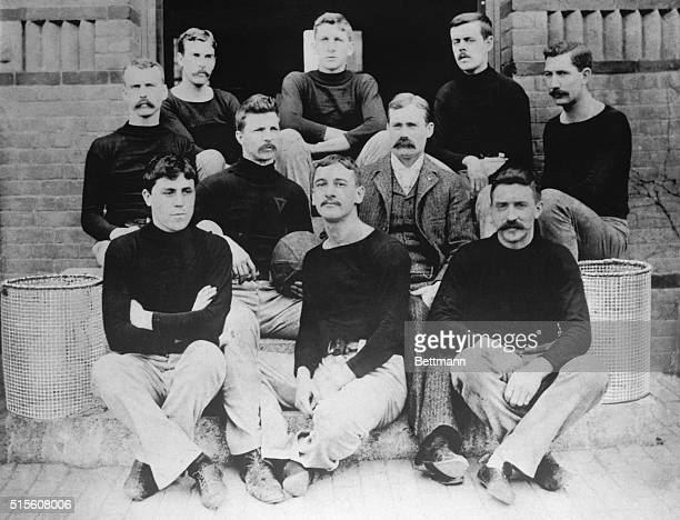 The first basketball team, consisting of nine players and their coach on the steps of the Springfield College Gymnasium in 1891 are shown. Dr....