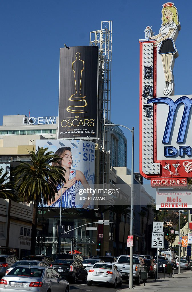 The first billboard (left) announcing this year's upcoming Oscars, the 85th Academy Awards, is displayed outside the Dolby Theatre in Hollywood, California, on February 14, 2013