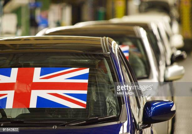 The first British built Honda Jazz family supermini wait for the production line to be opened at the Honda car plant in Swindon western England on...