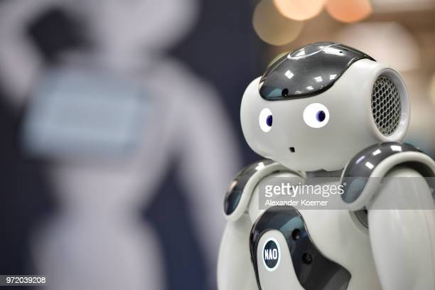 NAO the first built humanoid robot entertains visitors at the SoftBank Robotics stand at the 2018 CeBIT technology trade fair on June 12 2018 in...