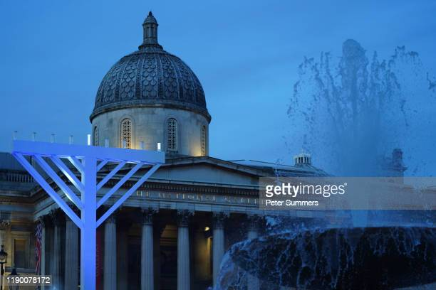 The first candle on the Menorah is lit during the Chanukah in the Square event a at Trafalgar Square on December 22, 2019 in London, England. The...