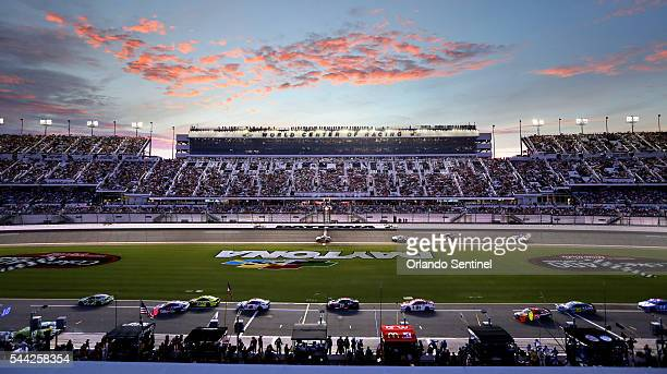 The first caution at lap 20 shows drivers on pit row early in the Coke Zero 400 at Daytona International Speedway in Daytona Beach Fla on Saturday...