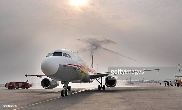 The first Chinamade Airbus A320 arrives at the Chengdu Shuangliu International Airport in Chengdu in southwest China's Sichuan province Tuesday June...