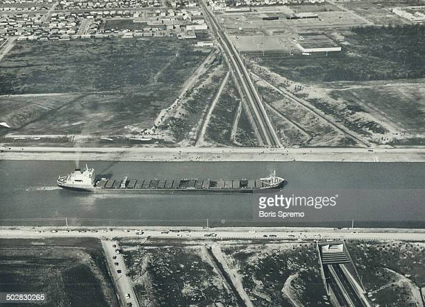 The first commercial ship to use the bypass in the Welland Canal between Port Colborne and Port Robinson was the laker Senneville which made the trip...