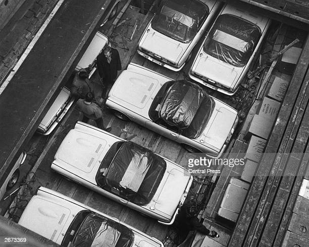 The first consignment of Honda S800 sports cars waiting to be unloaded at London docks