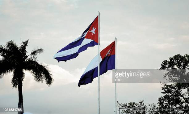 The first Cuban flag and the current one flutter during the celebrations for the 150th anniversary of the beginning of the independence war against...