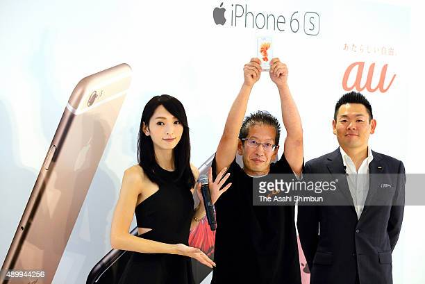 The first customer getting the new iPhone 6s poses for photographs at an au store on September 25 2015 in Nagoya Aichi Japan Apple launches the new...