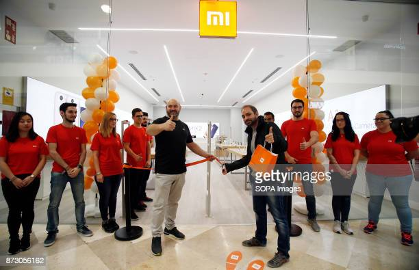 XANADú ARROYOMOLINOS MADRID SPAIN The first customer of the new Xiaomi store being pictured just before the official opening The company Xiaomi...