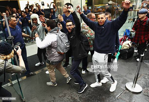 The first customers in line to buy the iPhone 7 walk into the Apple Store on September 16 2016 in Sydney Australia Apple's latest iPhone features a...