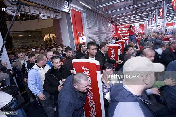 The first customers run into the electronic shopping center Mediamarkt at the shopping mall Alexa September 12 2007 in Berlin Germany The branch...