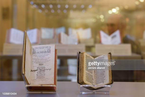 The first edition of the comedy 'Divina Commedia' from 1555 and a miniature edition of the work from 1516 by Dante Alighieri are seen at the...