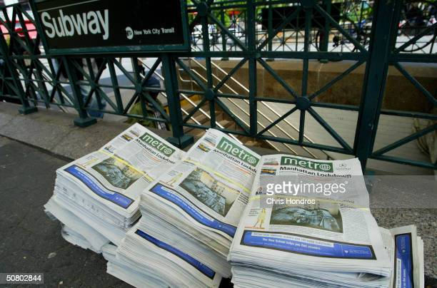 The first editions of Metro New York newspaper sit in stacks near a subway station May 5 2004 in Union Sqaure in New York Metro a free daily...