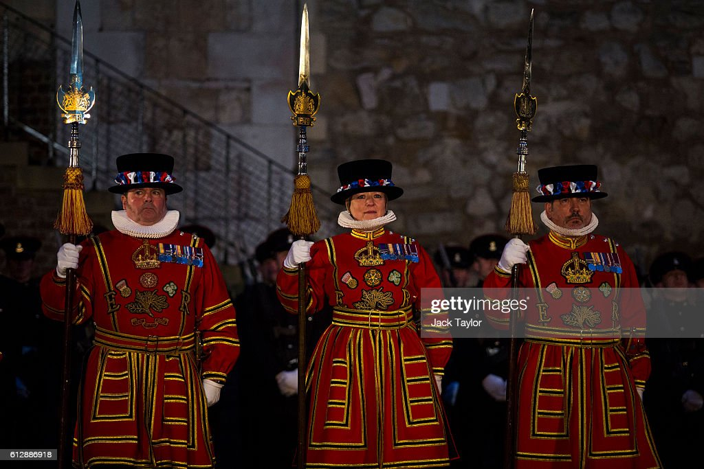 The first ever female Yeoman Warder Moira Cameron (C) and other 'Beefeaters', parade during the installation of General Sir Nicholas Houghton as the 160th Constable of the Tower of London during a ceremony in front of the White Tower at Tower of London on October 5, 2016 in London, England. The role of Constable, while largely ceremonial, is the most senior appointment at the Tower of London and one of the most ancient offices in England, dating back to around 1078.