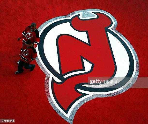 The first fans through the door walk across a logo on the atrium floor before a game between the Ottawa Senators and the New Jersey Devils at the...