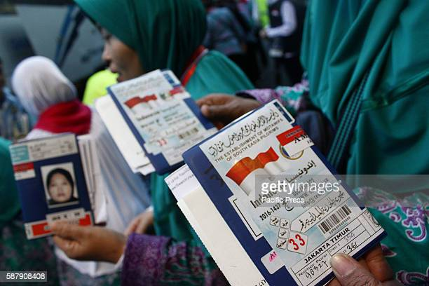 The first flight group of Indonesian pilgrims undergo inspection by officers before boarding the bus at Pondok Gede Hajj Dormitory which will carry...