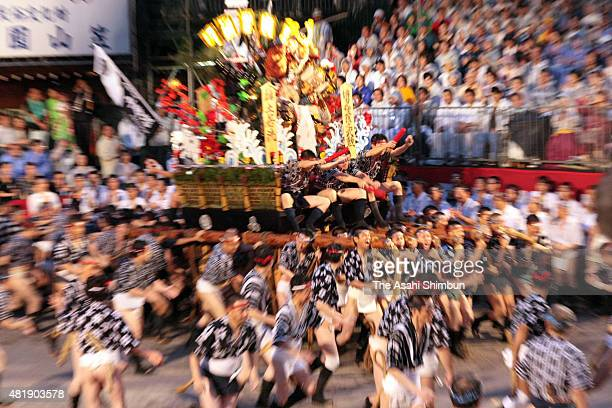 The first float 'DoiNagare' rushes through Seido Street of Kushida Jinja Shrine during the Hakata Gion Yamakasa festival on July 15 2010 in Fukuoka...