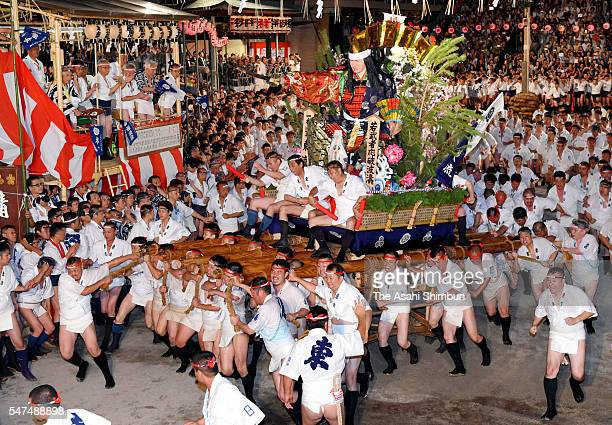 The first float 'Higashi Nagare' rushes through Seido Street of Kushida Jinja Shrine during the Hakata Gion Yamakasa festival on July 15 2016 in...