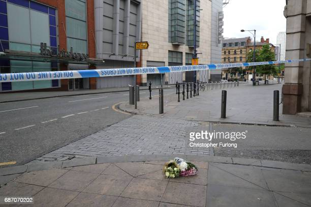 The first floral tributes to the victims of the terrorist attack are placed on the empty streets of Shudehill May 23 2017 in Manchester England An...